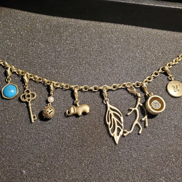 Lia Sophia Gold Charm bracelet with 8 charms